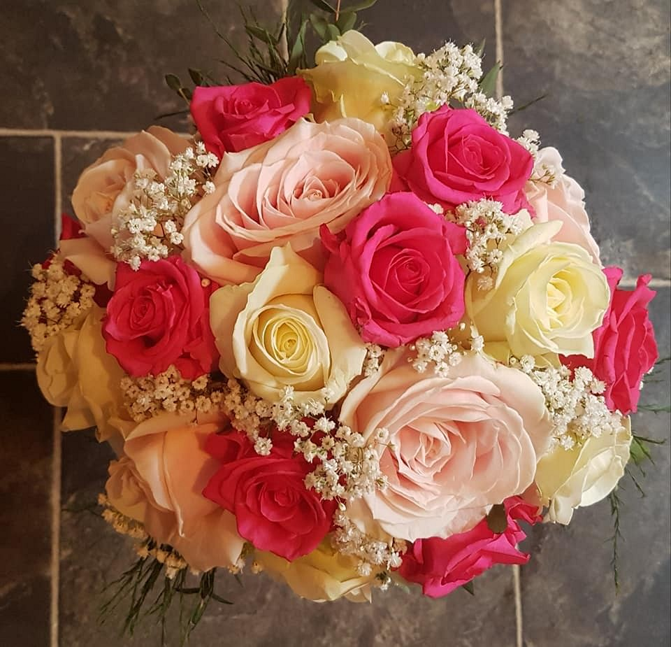 Bridal bouquet with cerise, blush and ivory roses with lots of gysophila