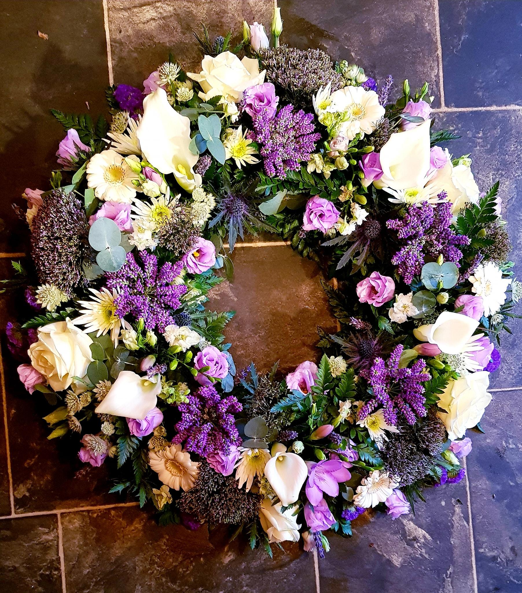 pink funeral wreath flowers